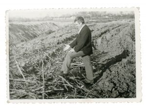 Cuţa pointing to remains after Communists destroyed family vineyard
