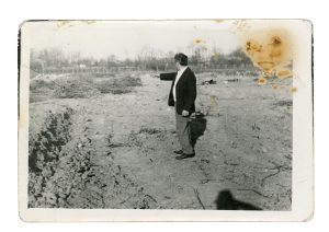 Cuţa documenting evidence of his family's vineyard destroyed by Communists